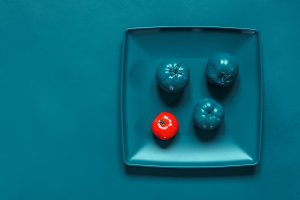 Painted Turquoise plate, cutlery and tomatoes