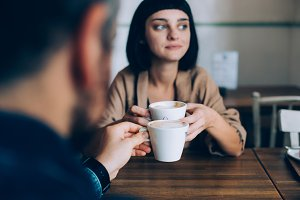 Couple drink coffee on date