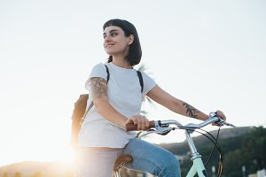 Woman with tattoo rides cruiser