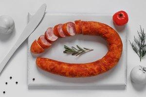 Smoked sausage on white cutting board