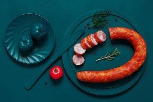 Smoked sausage on turquoise cutting board