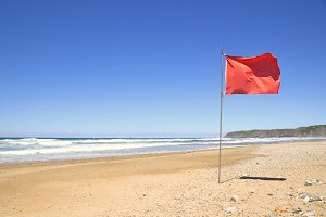 Red flag in the beach