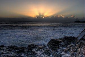Sunbeams At Sunrise Over The Ocean