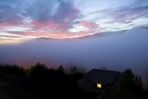 Mist Over Mountains At Sunset
