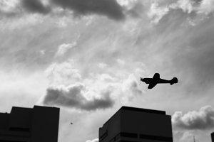 Monochrome Toy Plane Over City