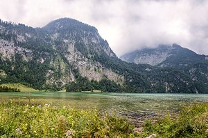 Scenic panoramic view of Konigssee in Bavaria a misty day