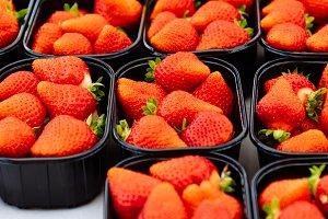 Fresh strawberries in street market
