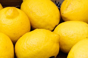Fresh yellow lemons in street market