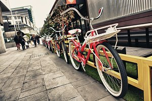 Vintage Red Bicycle Row On Street
