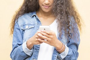 young afro woman using cellphone