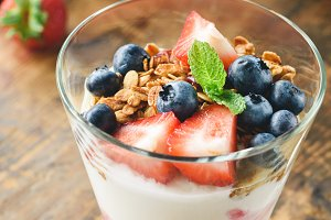 Yogurt parfait with granola, blueberry and strawberry