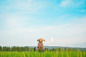 girl backpack in green field
