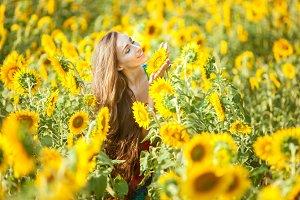 Happy woman on a flower field.