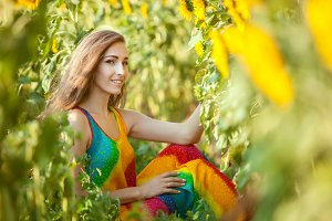 Sweet woman among sunflowers.