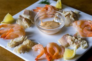 Shrimps and smoked trout on a plate