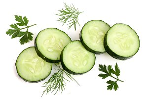 slices of cucumber with leaf parsley dill isolated on white background