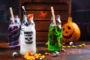 Assortment of Halloween drinks on grunge background