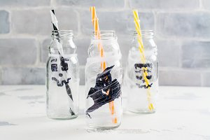 Empty bottles decorated for Halloween kids party