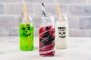 Assortment of Halloween drinks on white background