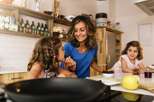 Little girls cooking with her mother