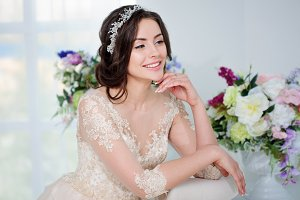 Portrait of beautiful girl in a luxurious wedding dress. Bride with beautiful decoration in her hair