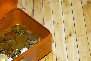 Euro coins on a wooden