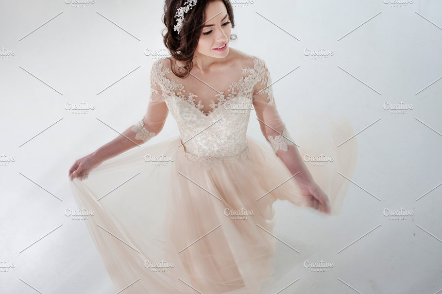 Dancing Beautiful In A Wedding Dress Bride Luxurious On White Background