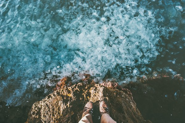 Feet above sea full of Jellyfish