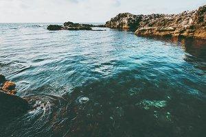 Blue Sea and rocky seaside Landscape
