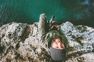 Happy Man relaxing on cliff