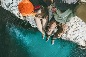 Couple in love above sea on cliff