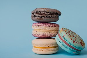 French colorful macarons on a blue background
