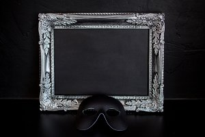 Carnival mask and beautiful silver frame with empty place for your text or design.