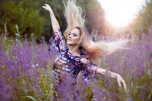 Beauty  girl alone with nature, freedom concept  , blond women in dress  on a meadow