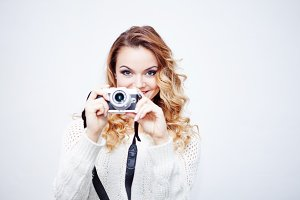young  woman photographer with camera, portrait on white background