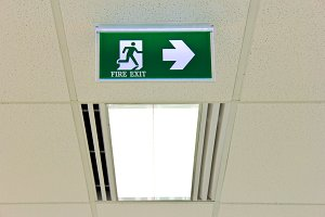 Fire exit sign on ceiling with light