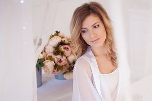 Portrait of beautiful woman model with fresh daily makeup and romantic wavy hairstyle.
