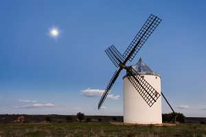 Typical windmill in with the moon at