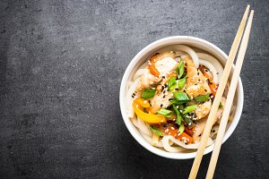 Udon stir-fry noodles with chicken and vegetables.