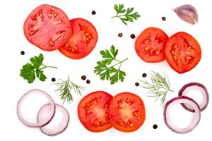 tomato slice with parsley leaves, dill, onion, garlic and peppercorns isolated on white background. Top view
