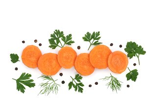 Fresh carrot slices with parsley dill and peppercorns isolated on white background with copy space for your text