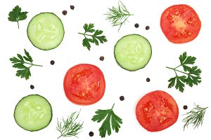 tomato and cucumber slice with parsley leaves, dill and peppercorns isolated on white background. Top view