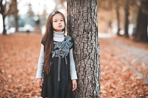 Stylish kid girl outdoors