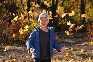 Cute boy in autumn park