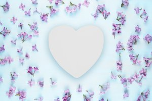 Blank wooden heart and lilac flowers
