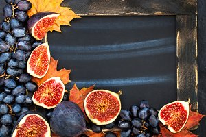 Autumn frame with figs, grape
