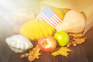 Thanksgiving in the States. Autumn harvest. Pumpkins, apples in the USA. American flag.
