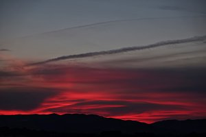 Red sky at sunset over mountains