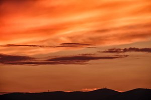 Orange sky at sunset over mountains