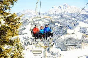 Family Riding In The Ski Lift